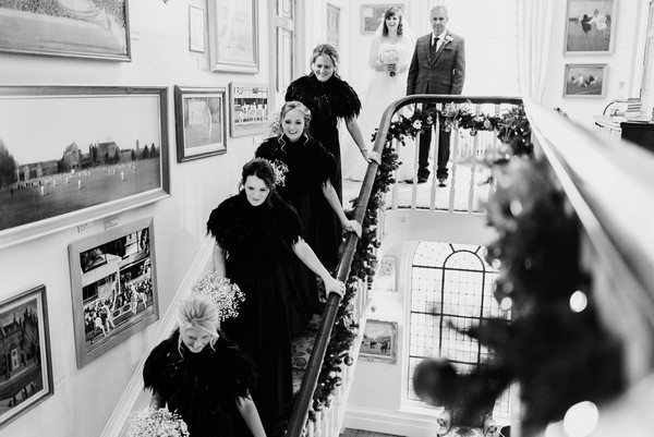 Row of bridesmaids walking down the stairs - Picture by Lee Maxwell Photography