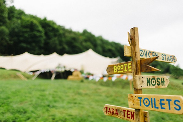 Wooden sign at festival wedding