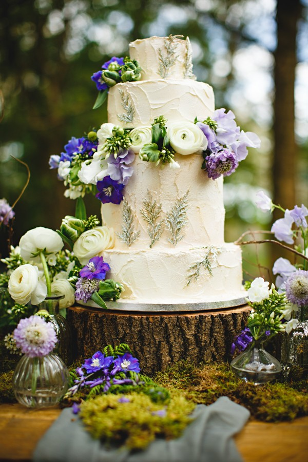 Wedding cake decorated with flowers on log slice