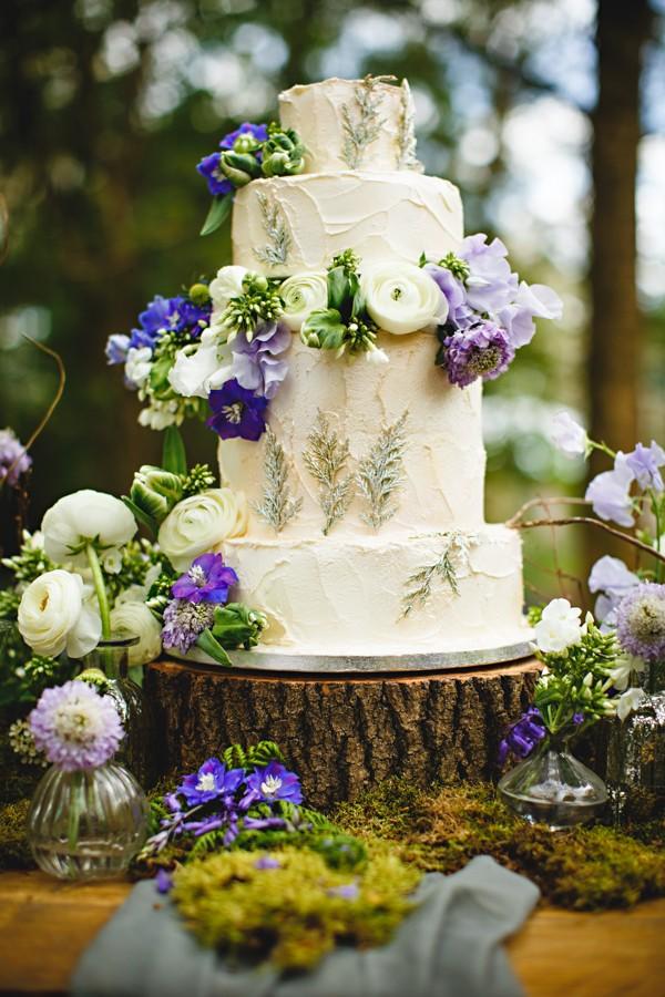 Wedding cake decorated with flowers on log slice