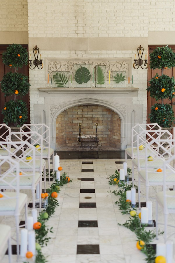 Wedding ceremony with citrus aisle styling