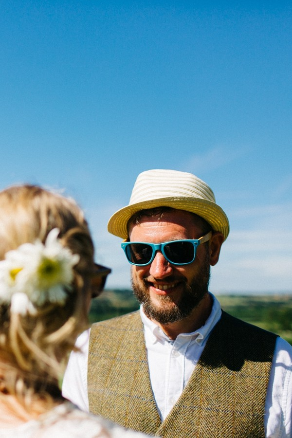 Groom wearing hat and sunglasses