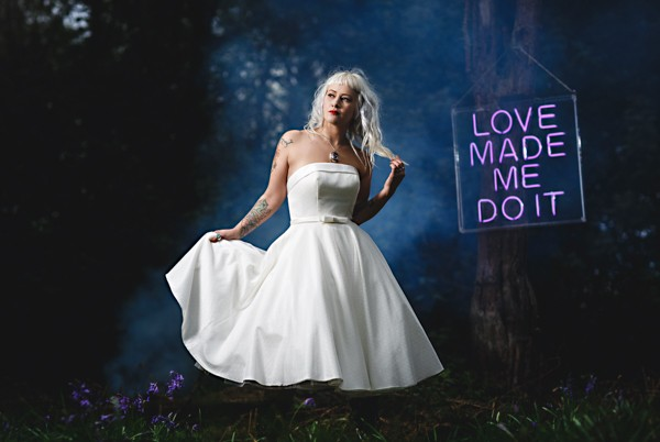 Rock n roll bride in front of neon sign and smoke