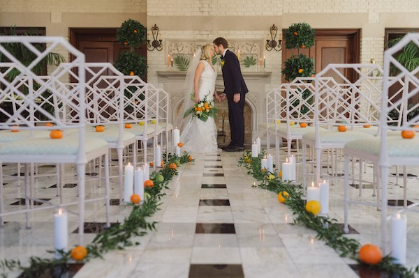 Bride and groom kissing in ceremony room