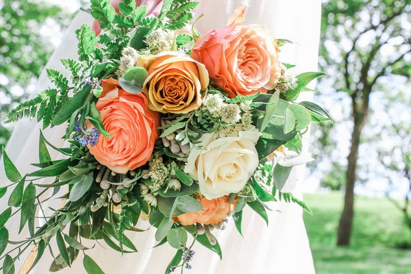 Wedding bouquet with blush pink and white roses