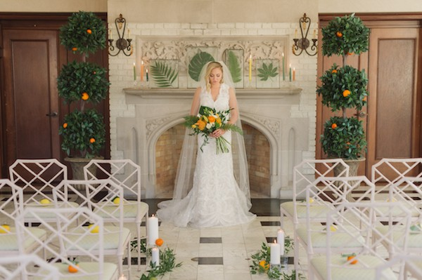 Bride standing in front of mantelpiece
