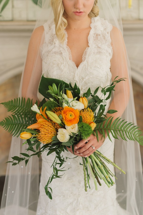 Bright orange flower and foliage bridal bouquet