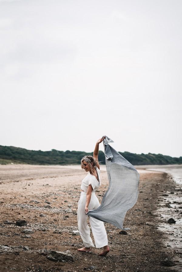 Bride on beach with shawl