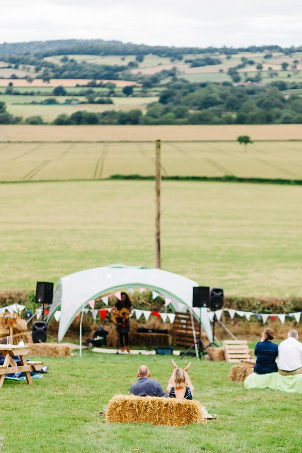 Musician performing in field at festival wedding
