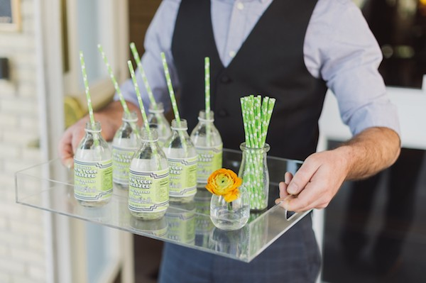 Tray of bottles with green straws