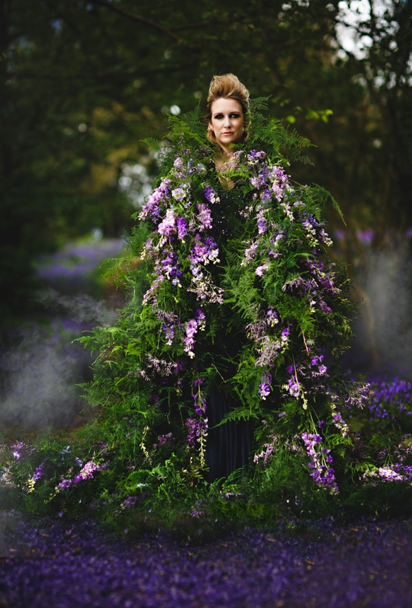 Bride wearing flower and foliage living cape