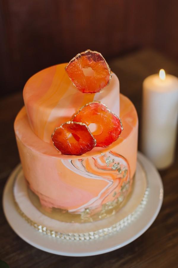 Orange geode style wedding cake