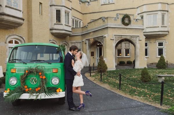 Bride and groom by green VW van