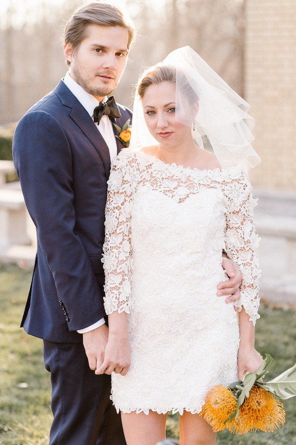 Groom with bride in short lace dress