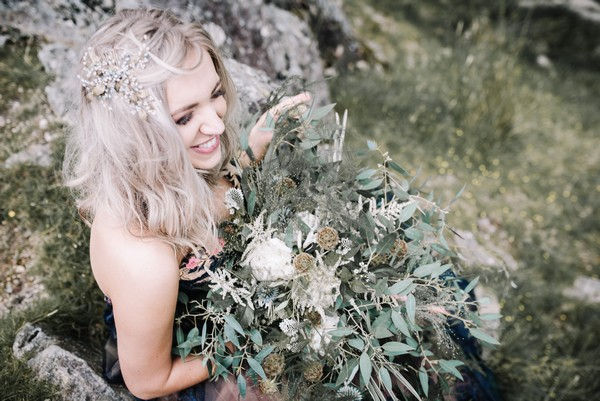 Bride holding rustic, natural wedding bouquet