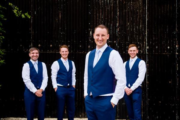 Groomsmen in blue waistcoats