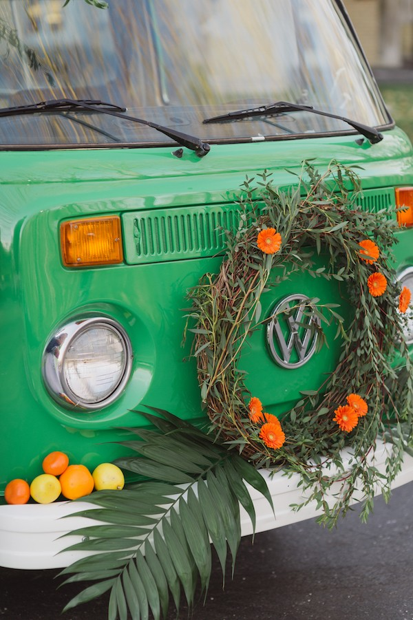 VW van with orange flower wreath and citrus fruits on the front