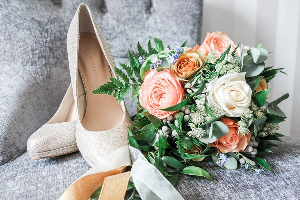 Bridal shoes and blush pink and white wedding bouquet