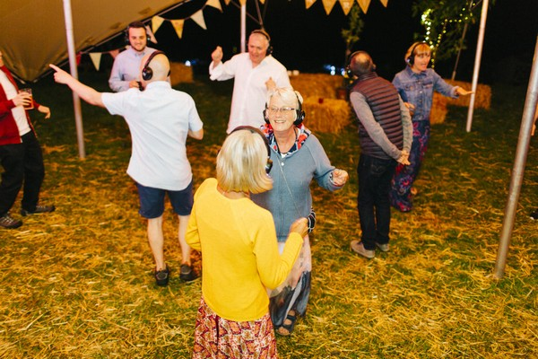 Wedding guests dancing to silent disco
