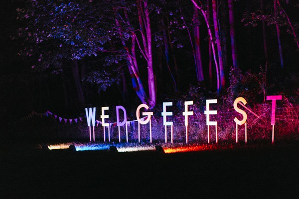 Wedgefest letters lit up at night