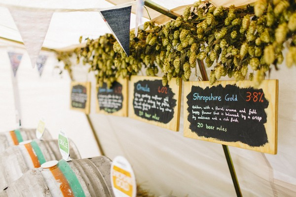 Ale signs in tent at wedding