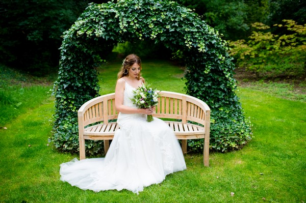 Bride sitting on bench