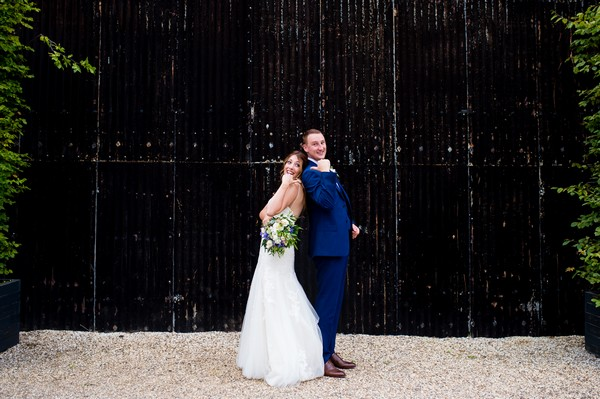 Bride and groom back to back