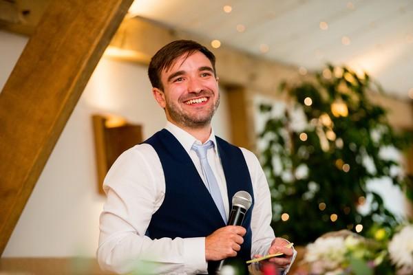 Best man smiling during speech
