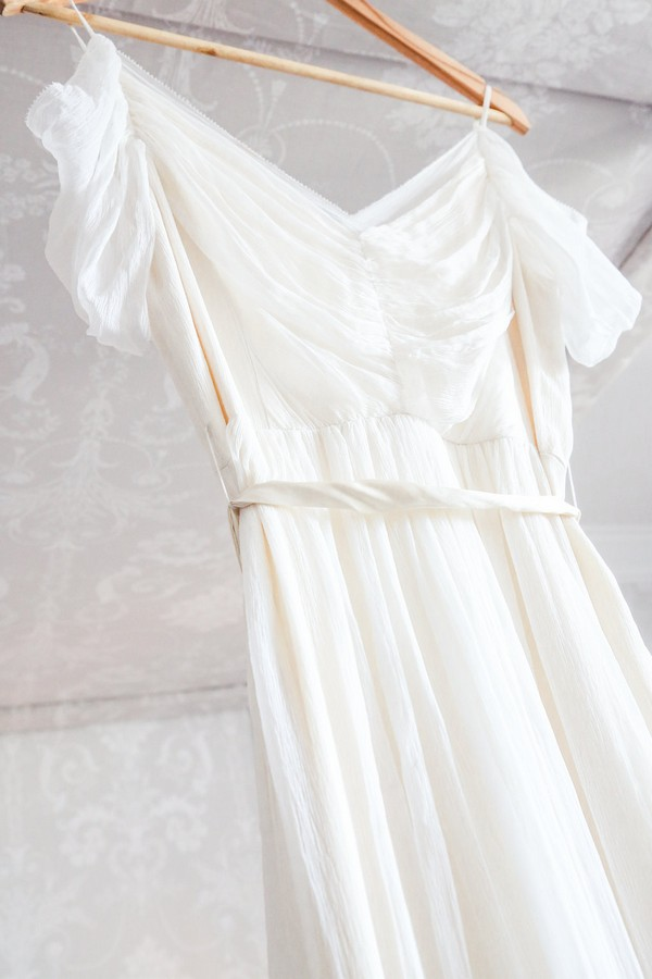 Wedding dress with draped detail