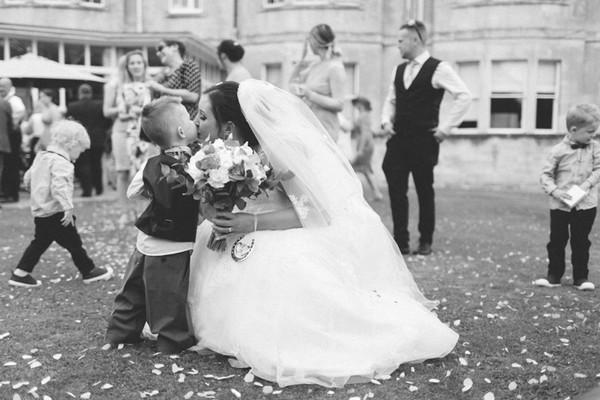 Bride kissing pageboy