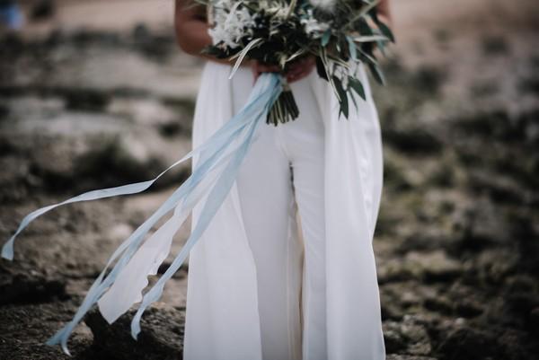 Blue ribbon on bridal bouquet