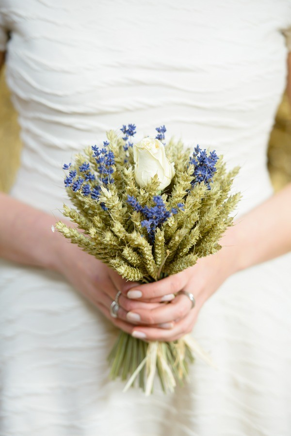 Bride Holding Lavender and Wheat Bouquet with Rose