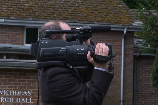 Videographer Filming Wedding