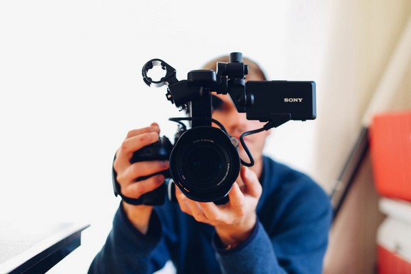 Videographer Holding Video Camera
