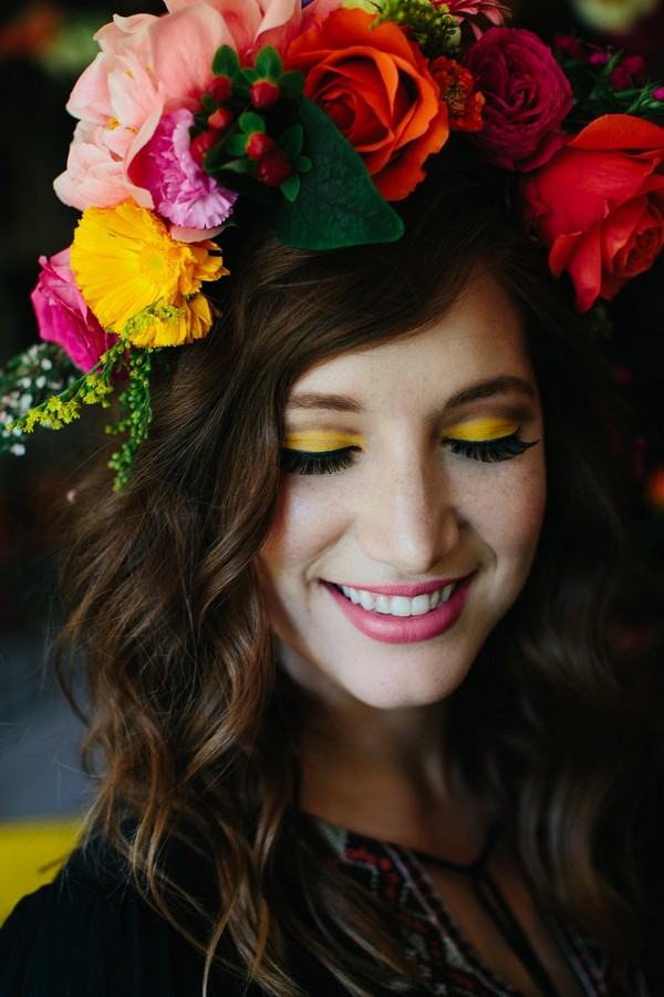 Woman with colourful flower crown and yellow eyeshadow