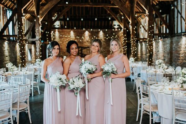 Bridesmaids in mauve bridesmaid dresses