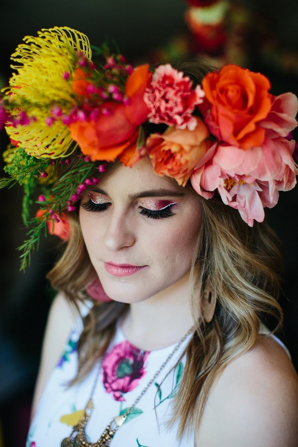 Woman with colourful floral crown and pink eyeshadow