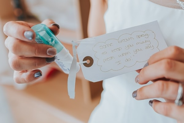 Breath freshener with tag