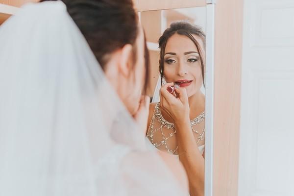 Bride doing lipstick