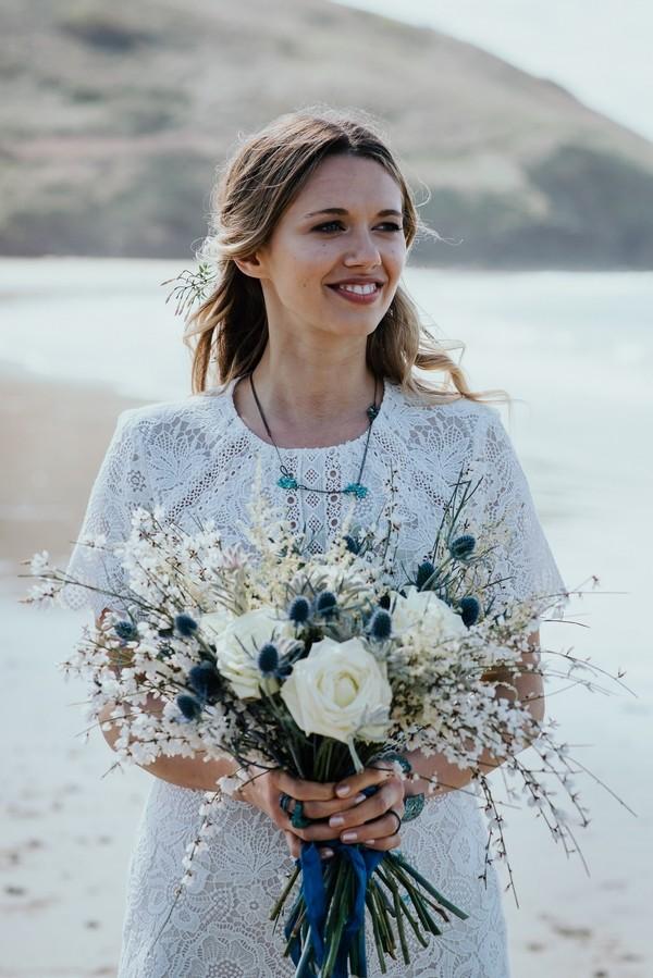 Bride holding rustic bouquet