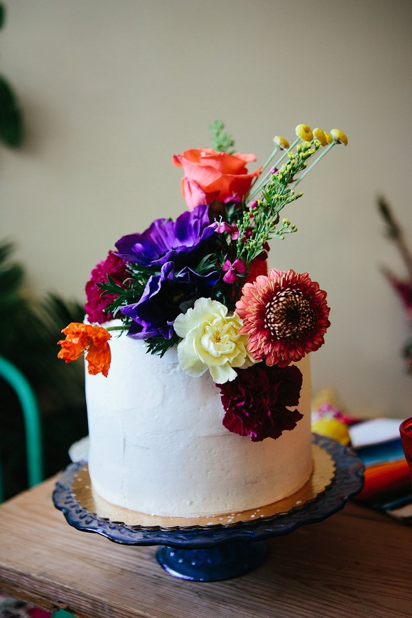White cake topped with colourful flowers