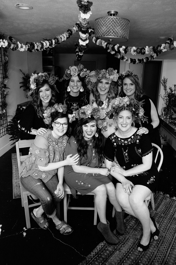 Women on Day of the Dead hen party posing for group photograph
