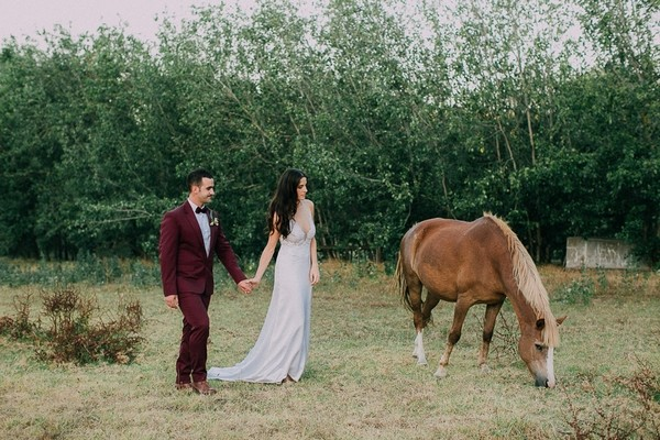 Bride and groom by horse