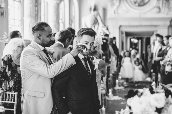 Best man wiping away groom's tears as bride walks down the aisle - Picture by Voyteck Photography