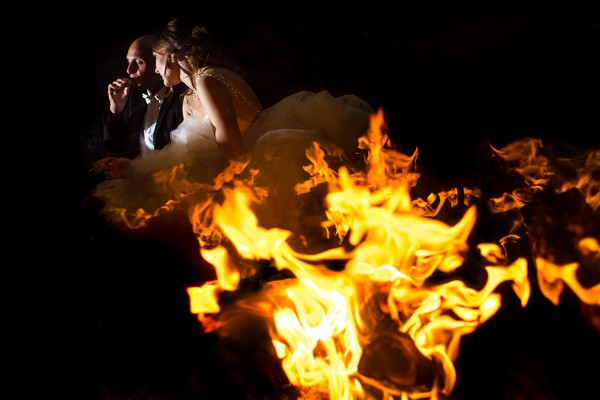 Bride and groom behind flames - Picture by Steven Herrschaft Photography