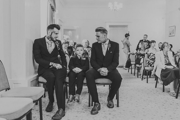 Groom, best man and pageboy waiting for bride