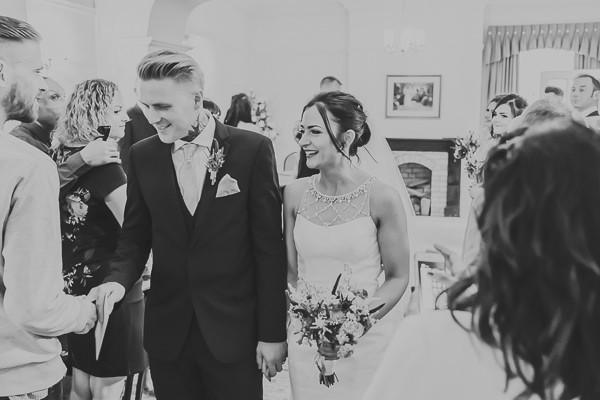 Bride and groom leave wedding ceremony