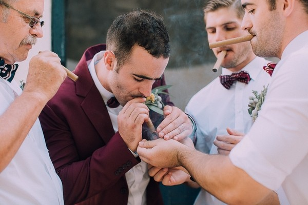 Groom lighting cigar