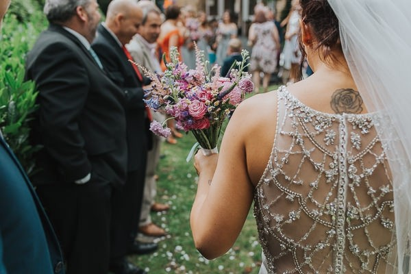 Beaded detail on back of bride's wedding dress