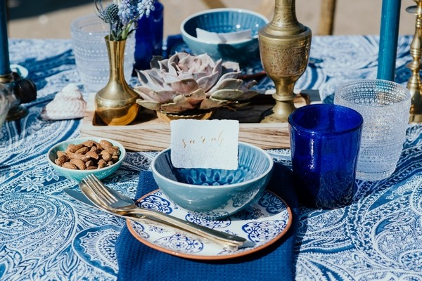 Wedding place setting with blue and gold styling